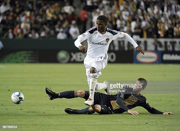 Edson Buddle of the Los Angeles Galaxy jumps over Christian Arrieta of the Philadelphia Union during the second half at the Home Depot Center on May...