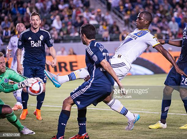 Edson Buddle of the Los Angeles Galaxy takes a shot on goal as David Ousted of Vancouver FC makes a save during the MLS match at the StubHub Center...