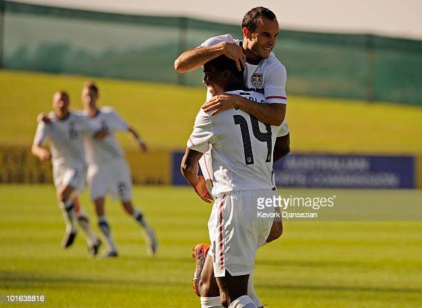 Edson Buddle of USA is congratulated by teammate Landon Donovan after scoring a goal against Australia during first half of the 2010 FIFA World Cup...