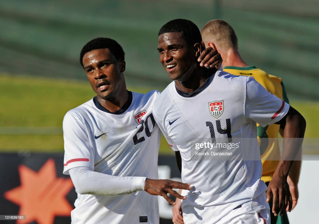 Edson Buddle #14 of USA is congratulated by teammate Robbie Findley #20 after scoring his second goal against Australia during first half of the 2010 FIFA World Cup Pre-Tournament match between the Australian Socceroos and the United States of America at Ruimsig Stadium on June 5, 2010 in Roodepoort, South Africa.