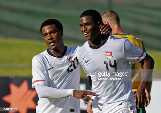 Edson Buddle of USA is congratulated by teammate Robbie Findley after scoring his second goal against Australia during first half of the 2010 FIFA...
