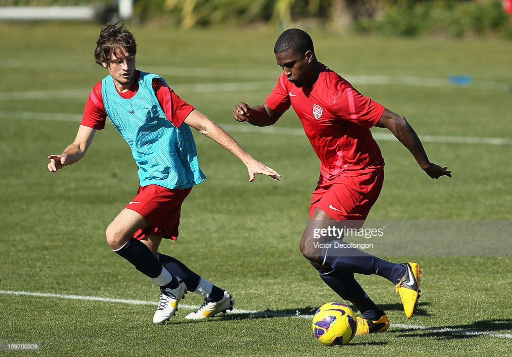 Edson Buddle paces the ball as Mix Diskerud (light blue jersey) defends the play during U.S. Men's Soccer Team training session at the Home Depot Center on January 17, 2013 in Carson, California.