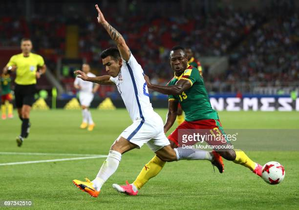Edson Puch of Chile and Christian Bassogog of Cameroon compete for the ball during the FIFA Confederations Cup Russia 2017 Group B match between...