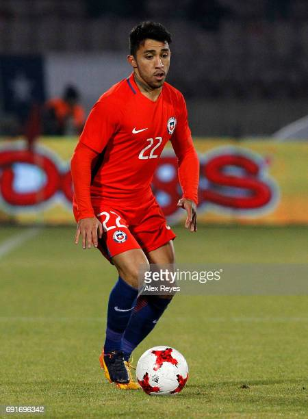Edson Puch of Chile drives the ball during a match between Chile and Burkina Faso as part of an International Friendly match at Nacional Stadium on...