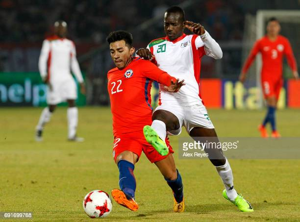 Edson Puch of Chile fights for the ball with Ernest Congo of Burkina Faso during a match between Chile and Burkina Faso as part of an International...