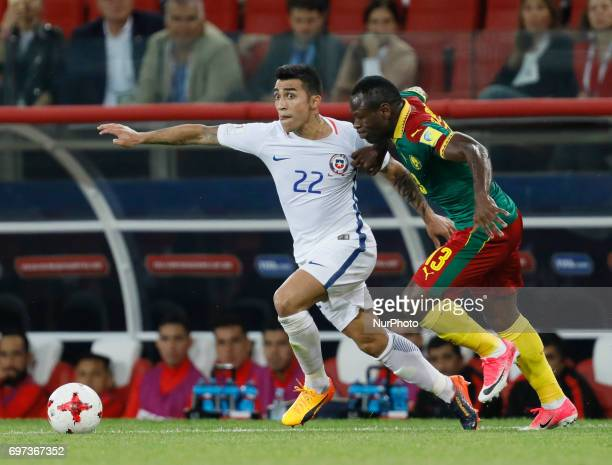 Edson Puch of Chile national team and Christian Bassogog of Cameroon national team during the Group B FIFA Confederations Cup Russia 2017 match...