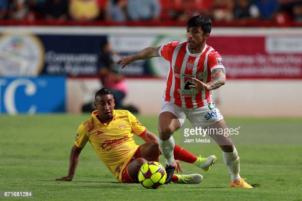 Edson Puch of Necaxa dribbles Rodolfo Vilchis of Morelia during the 15th round match between Necaxa and Morelia as part of the Torneo Clausura 2017...
