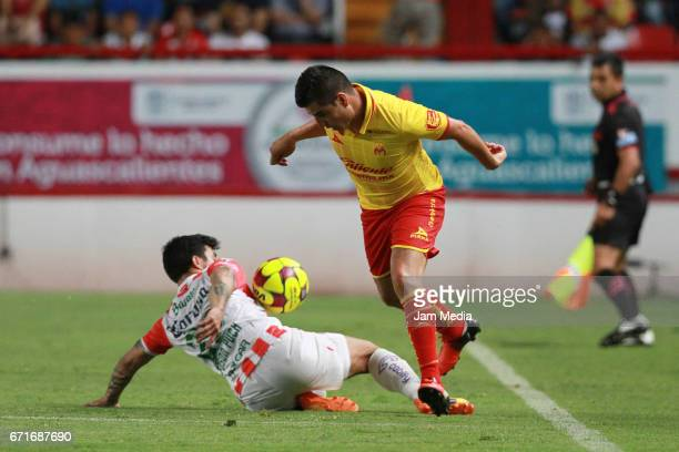 Edson Puch of Necaxa slides for the ball during the 15th round match between Necaxa and Morelia as part of the Torneo Clausura 2017 Liga MX at...