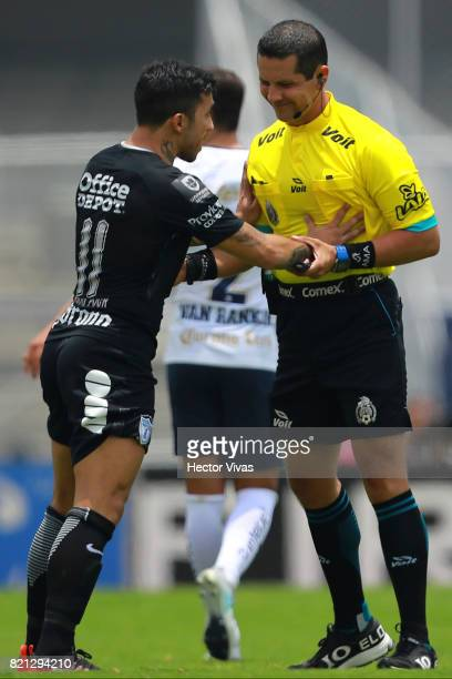 Edson Puch of Pachuca argues with the referee Diego Montaño during the 1st round match between Pumas UNAM and Pachuca as part of the Torneo Apertura...