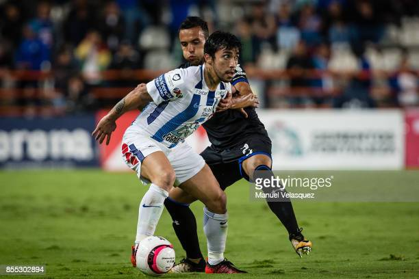 Edson Puch of Pachuca struggles for the ball against Omar Mendoza of Cruz Azul during the 11th round match between Pachuca and Cruz Azul as part of...