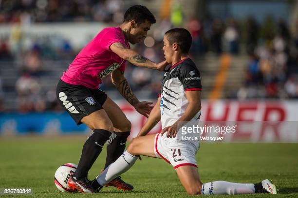 Edson Puch of Pachuca struggles for the ball with Eduardo Tercero of Lobos BUAP during the third round match between Lobos BUAP and Pachuca as part...