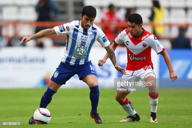 Edson Puch of Pachuca struggles for the ball with Jesus Paganoni of Veracruz during the sixth round match between Pachuca and Veracruz as part of the...