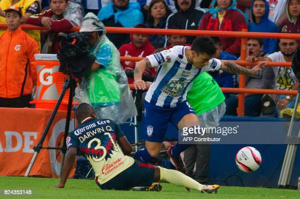 Edson Puch of Pachuca vies for the ball with Darwin Quintero of America during their Mexican Apertura 2017 Tournament football match at Hidalgo...