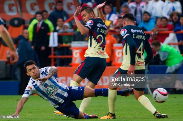 Edson Puch of Pachuca vies for the ball with Paul Aguilar and Edson Alvarez of America during their Mexican Apertura 2017 Tournament football match...