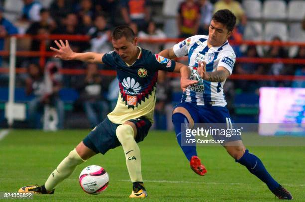 Edson Puch of Pachuca vies for the ball with Paul Aguilar of America during their Mexican Apertura 2017 Tournament football match at Hidalgo stadium...