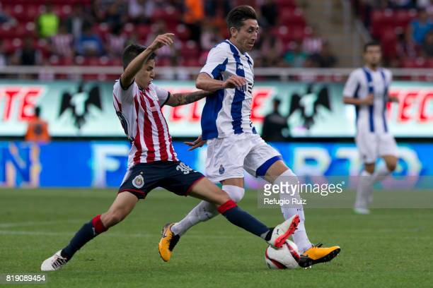 Edson Torres of Chivas fights for the ball with Hector Herrera of Porto during the friendly match between Chivas and Porto at Chivas Stadium on July...