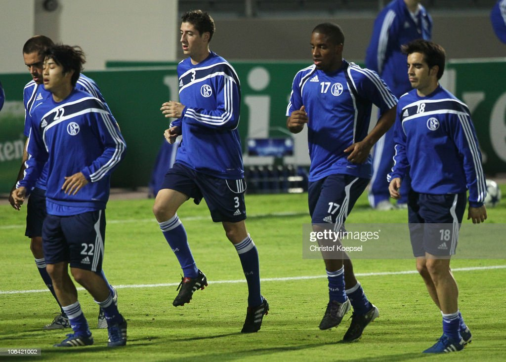 Edu, <a gi-track='captionPersonalityLinkClicked' href=/galleries/search?phrase=Atsuto+Uchida&family=editorial&specificpeople=4318608 ng-click='$event.stopPropagation()'>Atsuto Uchida</a>, Sergio Escudero, <a gi-track='captionPersonalityLinkClicked' href=/galleries/search?phrase=Jefferson+Farfan&family=editorial&specificpeople=791155 ng-click='$event.stopPropagation()'>Jefferson Farfan</a> and Jose Jurado run during a FC Schalke 04 training session ahead of the UEFA Champions League match against Hapoel Tel Aviv at Bloomfield stadium on November 1, 2010 in Tel Aviv, Israel.