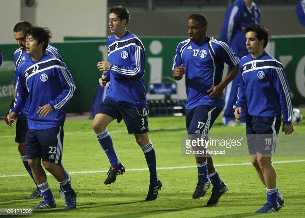 Edu Atsuto Uchida Sergio Escudero Jefferson Farfan and Jose Jurado run during a FC Schalke 04 training session ahead of the UEFA Champions League...