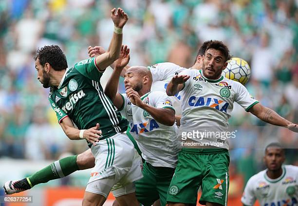Edu Dragena of Palmeiras fights for the ball with Filipe Machado Alan Ruschel and Sergio Manoel of Chapecoense during the match between Palmeiras and...