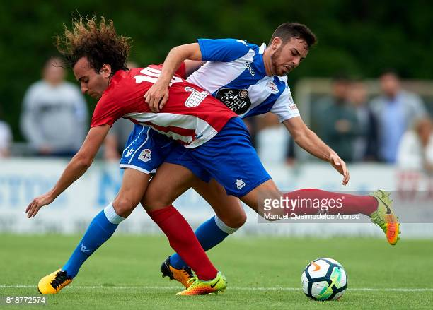 Edu Exposito of Deportivo de La Coruna competes for the ball with Carlos of Cerceda during the preseason friendly match between Cerceda and Deportivo...