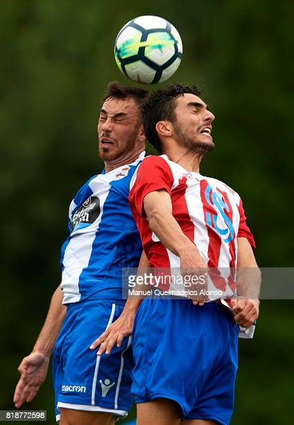 Edu Exposito of Deportivo de La Coruna competes for the ball with Pedrosa of Cerceda during the preseason friendly match between Cerceda and...