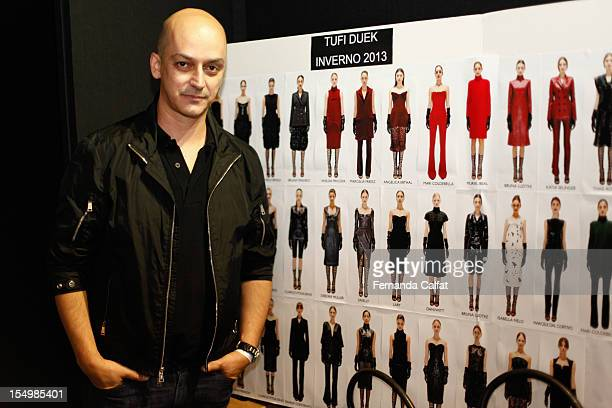 Edu Pombal poses backstage before the Tufi Duek show 2013 Fall/Winter collection in Sao Paulo Fashion Week at Villa Lobos Park on October 29 2012 in...