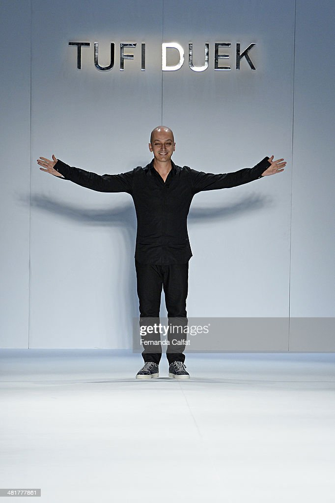 Edu Pombal walks the runway during Tufi Duek show at Sao Paulo Fashion Week Summer 2014/2015 at Parque Candido Portinari on March 31, 2014 in Sao Paulo, Brazil.