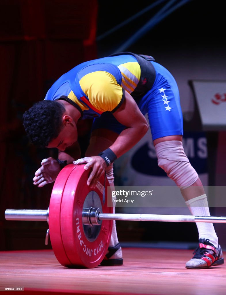 Eduar Beris of Venezuela B celebrates his victory in the Men's 56kg during day one of the 2013 Junior Weightlifting World Championship at Maria Angola Convention Center on April 04, 2013 in Lima, Peru.