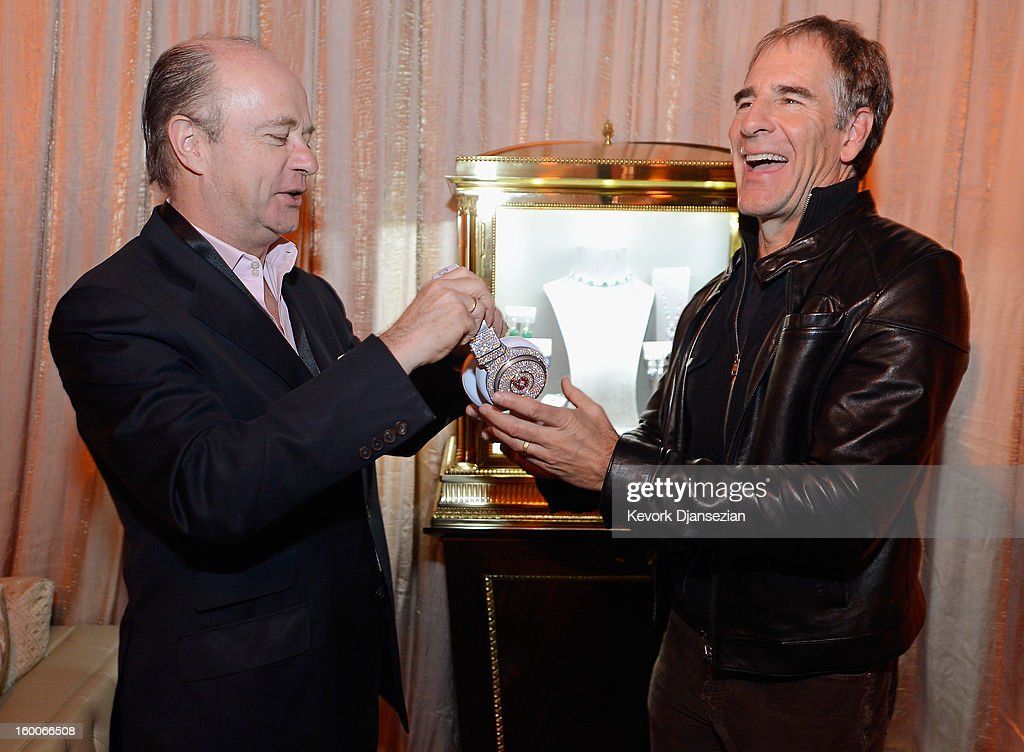 Eduard E. van der Geest (L) director of sales at Graff Diamonds takes the Beats by Dre headphones created by Graff Diamonds, which are adorned with more than 114 carats in diamonds worth $1 million dollars, from SAG Awards Committee member actor Scott Bakula during the 19th Annual Screen Actor Guild Awards ceremony behind the scenes event at The Shrine Auditorium on January 25, 2013 in Los Angeles, California.