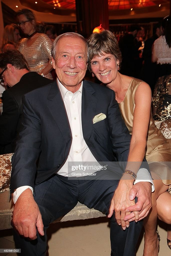 Eduard 'Edi' Reinbold and his wife Claudia Reinbold attend the Eclat Dore summer party at Hotel Vier Jahreszeiten Kempinski on July 23, 2014 in Munich, Germany.