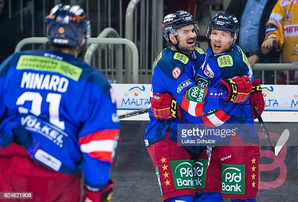 Eduard Lewandowski of Duesseldorf celebrates his first goal with teammate Marco Nowak during the DEL match between Duesseldorfer EG and Koelner Haie...