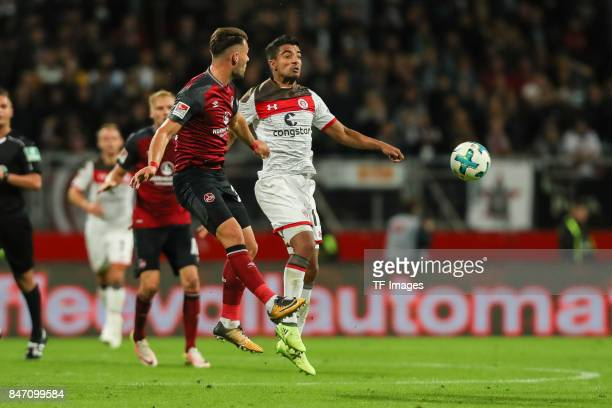 Eduard Loewen of Nuernberg und Sami Allagui of St Pauli battle for the ball during the Second Bundesliga match between 1 FC Nuernberg and FC St Pauli...
