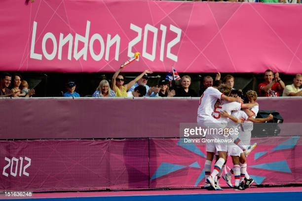 Eduard Ramonov of Russian celebrates with teammates after scoring his team's first goal during the Men's Team Football 7aside Gold Medal match...