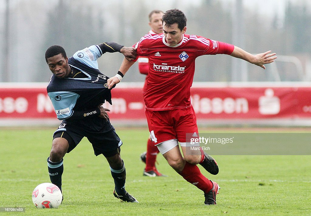Eduard Thommy of Illertissen (R) challenges Kodjovi Koussou of Muenchen (L) during the Regionalliga Bayern match between FV Illertissen and 1860 Muenchen II at Voehlinstadion on April 20, 2013 in Illertissen, Germany.