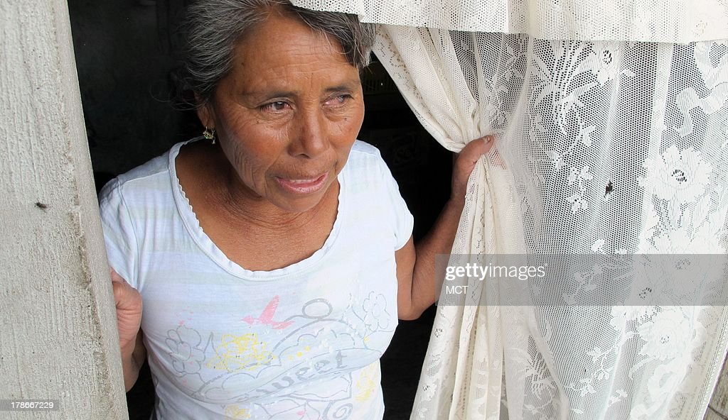 Eduarda Espinoza, seen peeking out the door of her rustic home in Mexico's Tlaxcala state August 21, 2013, says jobs are lacking in her region, keeping Mexicans trapped in poverty. Mexico is launching a crusade against poverty, a condition that defines the lives of 45 percent of its population.