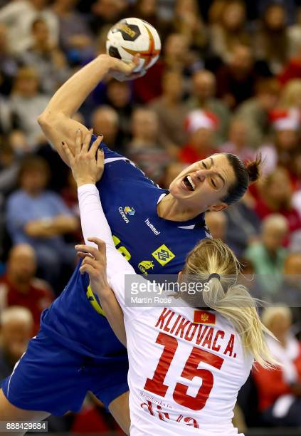 Eduarda Taleska of Brazil challenges Andrea Klikovac of Montenegro during the IHF Women's Handball World Championship group C match between Brazil...