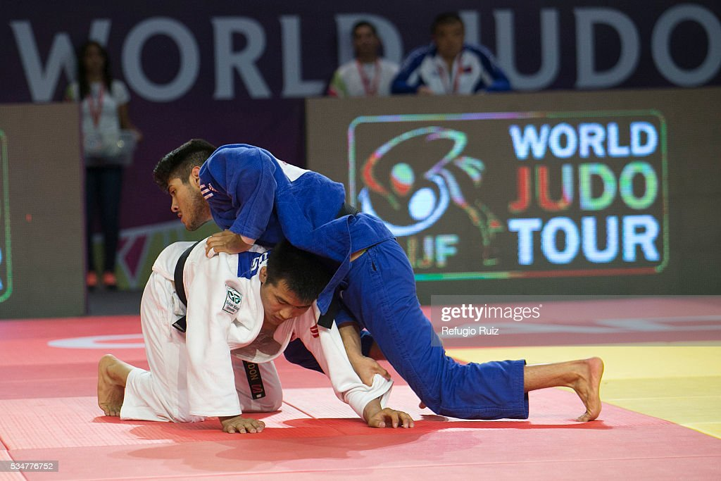Eduardo Araujo (Blue) of Mexico competes against Altansukh Dovdon (white) of Mongolia during the men's -66kg fight as part of the World Judo Masters Guadalajara 2016 at Adolfo Lopez Mateos Sports Centre on May 27, 2016 in Gudalajara, Mexico.
