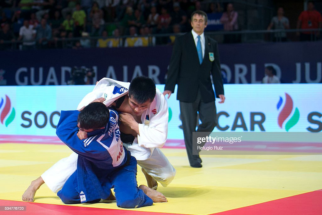 Eduardo Araujo (Blue) of Mexico fighst against Altansukh Dovdon (white) of Mongolia during the men's -66kg fight as part of the World Judo Masters Guadalajara 2016 at Adolfo Lopez Mateos Sports Centre on May 27, 2016 in Gudalajara, Mexico.