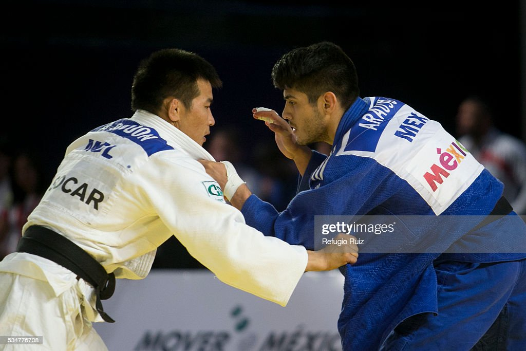 Eduardo Araujo (Blue) of Mexico holds Altansukh Dovdon (white) of Mongolia during the men's -66kg fight as part of the World Judo Masters Guadalajara 2016 at Adolfo Lopez Mateos Sports Centre on May 27, 2016 in Gudalajara, Mexico.