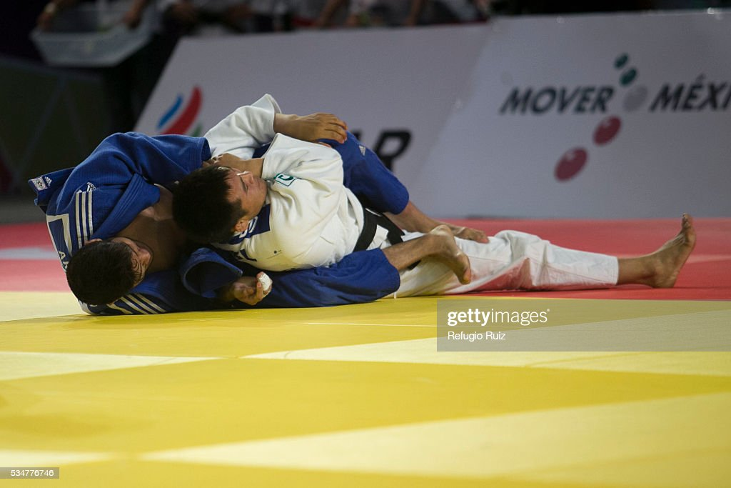 Eduardo Araujo (Blue) of Mexico strangles Altansukh Dovdon (white) of Mongolia during the men's -66kg fight as part of the World Judo Masters Guadalajara 2016 at Adolfo Lopez Mateos Sports Centre on May 27, 2016 in Gudalajara, Mexico.