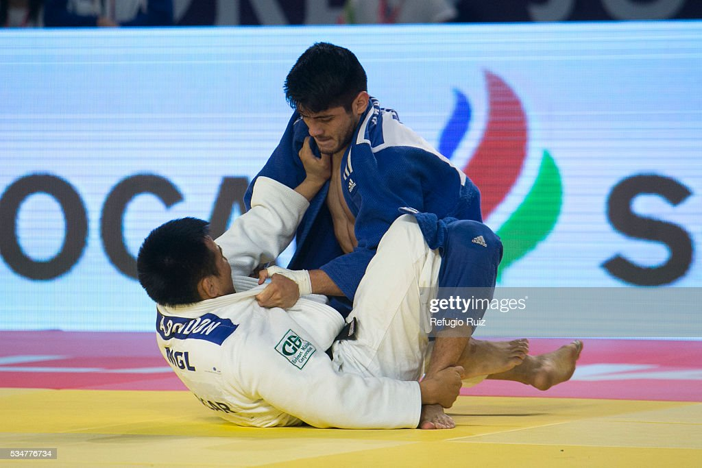 Eduardo Araujo (Blue) of Mexico takes down Altansukh Dovdon (white) of Mongolia during the men's -66kg fight as part of the World Judo Masters Guadalajara 2016 at Adolfo Lopez Mateos Sports Centre on May 27, 2016 in Gudalajara, Mexico.
