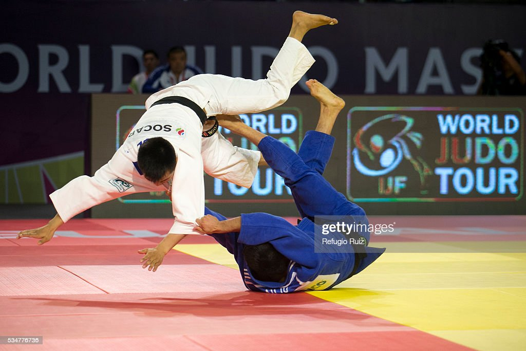 Eduardo Araujo (Blue) of Mexico throws Altansukh Dovdon (white) of Mongolia with a foot sweep during the men's -66kg fight as part of the World Judo Masters Guadalajara 2016 at Adolfo Lopez Mateos Sports Centre on May 27, 2016 in Gudalajara, Mexico.
