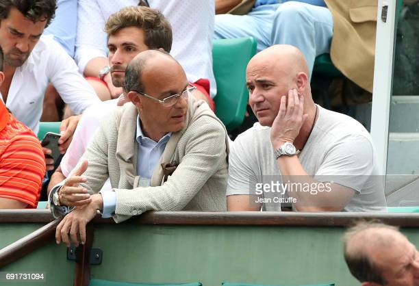 Eduardo Ataidi agent of Novak Djokovic of Serbia and his coach Andre Agassi on day 6 of the 2017 French Open second Grand Slam of the season at...