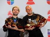 Eduardo Cabra Martinez aka Visitante and Rene Perez Joglar aka Residente of the musical groupe Calle 13 pose in the press room with their multiple...