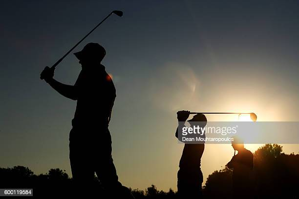 Eduardo de la Riva of Spain and Oliver Wilson of England hit shots on the driving range before the first round on day one of the KLM Open at The...