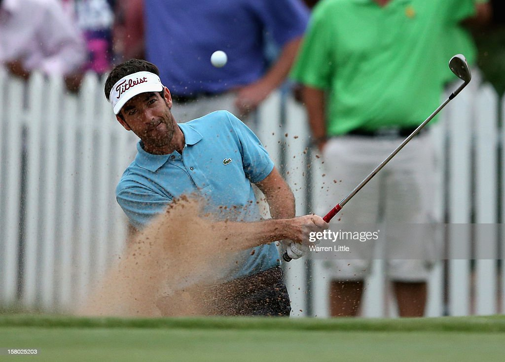 Eduardo de la Riva of Spain plays out of the 18th greenside bunker in the first extra play-off hole during the second round of The Nelson Mandela Championship presented by ISPS Handa at Royal Durban Golf Club on December 9, 2012 in Durban, South Africa.