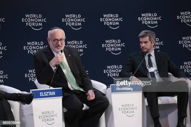 Eduardo Elsztain chairman and chief executive officer of IRSA Inversiones y Representaciones SA left speaks while Marcos Pena Argentina's cabinet...