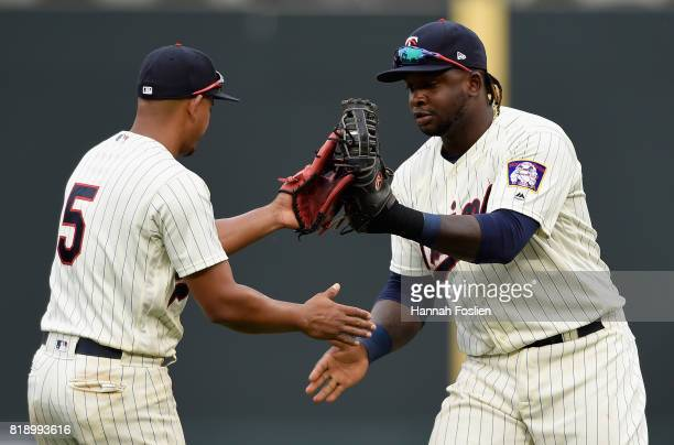 Eduardo Escobar and Miguel Sano of the Minnesota Twins celebrates winning the game against the New York Yankees on July 19 2017 at Target Field in...