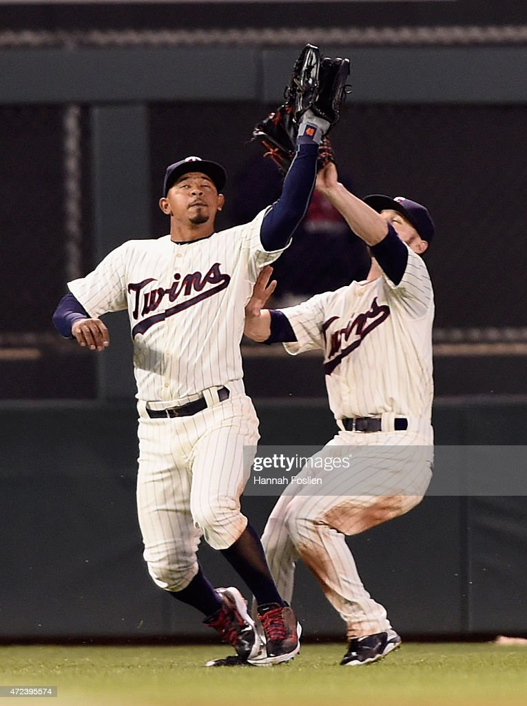 Eduardo Escobar #5 and Shane Robinson #21 of the Minnesota Twins collide on a ball off the bat of Eric Sogard #28 of the Oakland Athletics during the fifth inning on May 6, 2015 at Target Field in Minneapolis, Minnesota. Escobar made the catch. The Twins defeated Athletics 13-0.