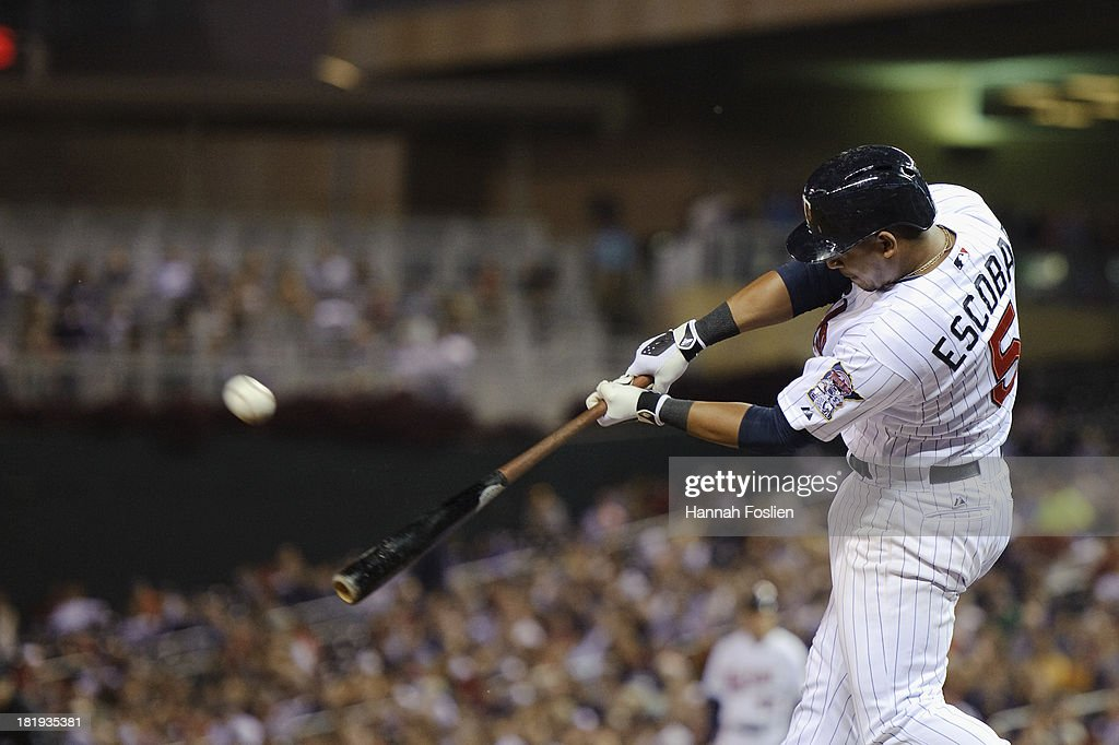 <a gi-track='captionPersonalityLinkClicked' href=/galleries/search?phrase=Eduardo+Escobar&family=editorial&specificpeople=7522733 ng-click='$event.stopPropagation()'>Eduardo Escobar</a> #5 of the Minnesota Twins bats against the Detroit Tigers during the game on September 24, 2013 at Target Field in Minneapolis, Minnesota.